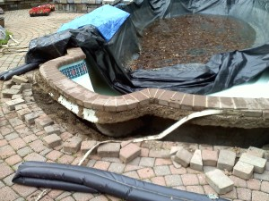 A fiberglass pool that popped out of the ground after sitting empty.